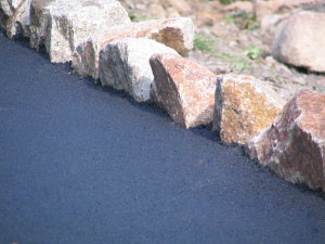 Stunning large rock feature edged driveway designs