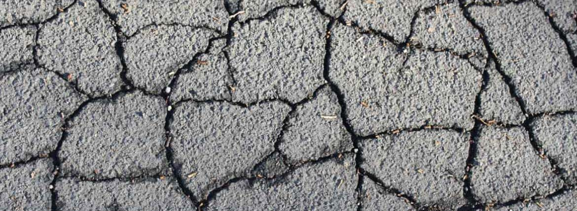 Cracked asphalt needing asphalt repairs